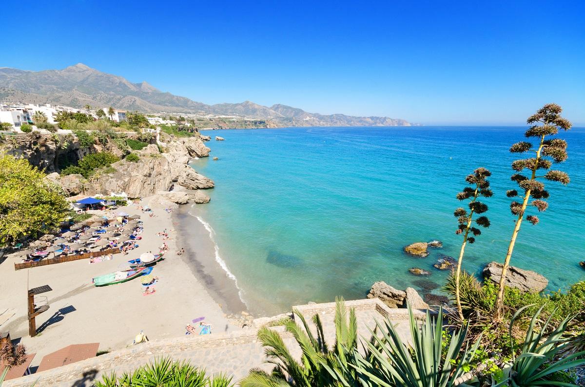 Nerja beach, famous touristic town in costa del sol, Malaga, Andalusia, Spain. - shutterstock_193320899